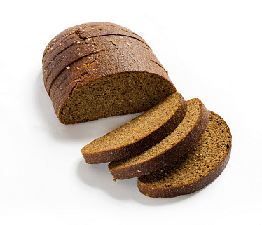 Sliced brown rye bread with shadow on white background. Clipping path included.